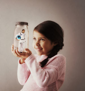 Photo of a girl imagining a career as an astronaut.