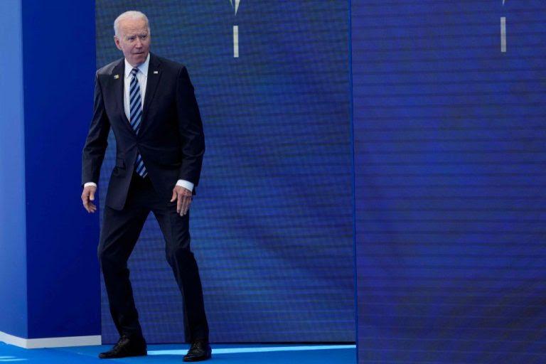 Joe Biden crouches