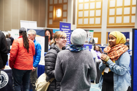 2018 Community Connections Conference exhibit hall visitors conversing