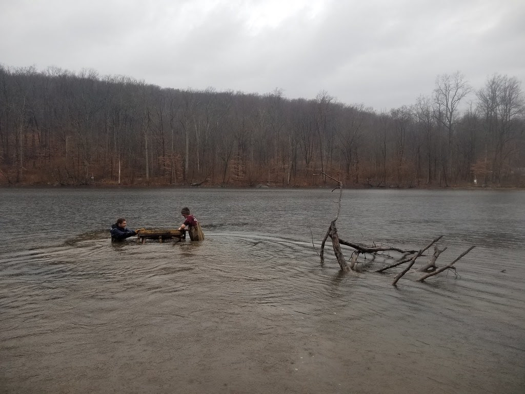 Photo of staff deploying fish habitat made from recycled materials