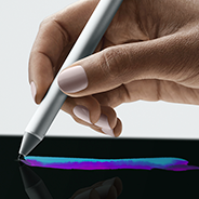 A hand holding Pen draws a multi-colored line on a computer screen.