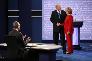 Donald J. Trump and Hillary Clinton at the first presidential debate, held at Hofstra University in Hempstead, N.Y, on Monday night. The moderator, Lester Holt of NBC, is at left.