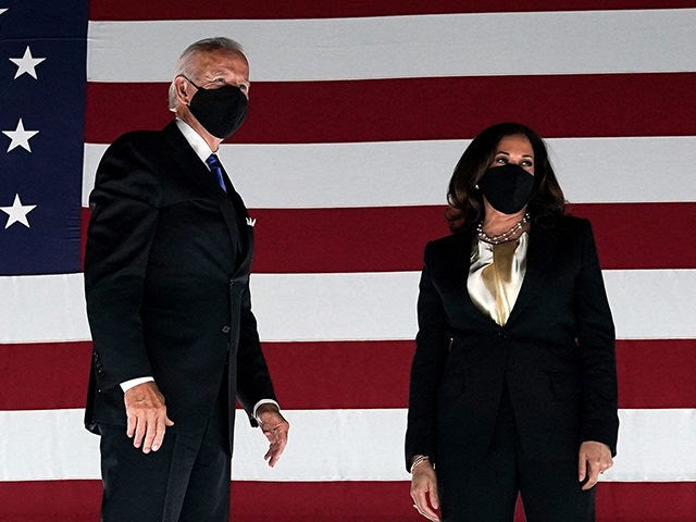 TOPSHOT - Former vice-president and Democratic presidential nominee Joe Biden (L) and Senator from California and Democratic vice presidential nominee Kamala Harris greet supporters outside the Chase Center in Wilmington, Delaware, at the conclusion of the Democratic National Convention, held virtually amid the novel coronavirus pandemic, on August 20, 2020. …