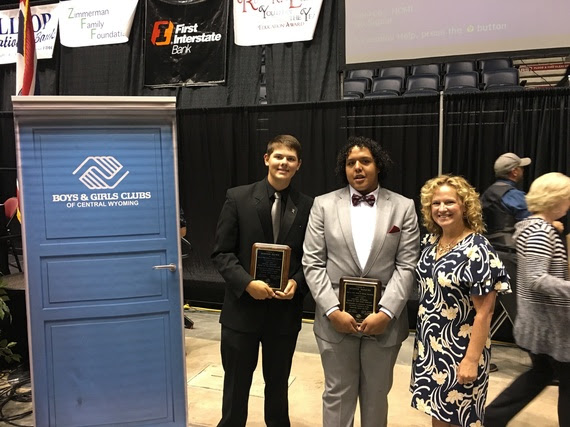 The runners up for Youth of the Year hold their plaques and pose with the State Superintendent at the Casper Events Center, next to a sign for Boys & Girls Clubs of Central Wyoming