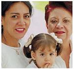 Latina mother, grandmother and daughter posing for photograph