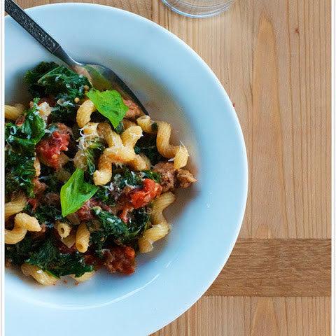 Cavatappi Pasta with Turkey Sausage, Broccoli, Cannellini Beans, Broccoli, Romano Cheese and Roasted Garlic Tomato Sauce