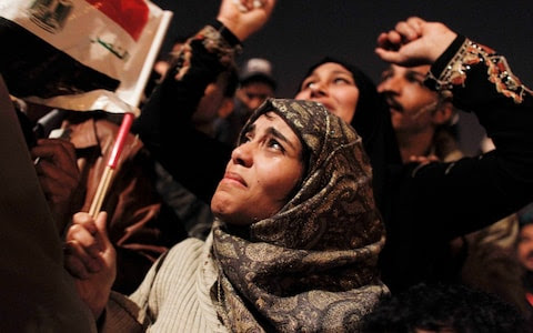 An Egyptian woman cries as she celebrates the news of the resignation of President Hosni Mubarak