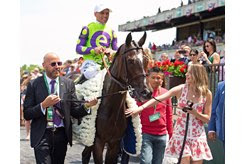 (L-R): Bob Edwards leads Javier Castellano and Rushing Fall along with daughter Casi Edwards after the 2019 Just a Game Stakes at Belmont Park