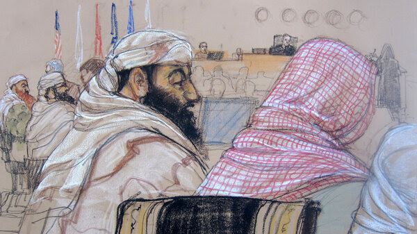 In this Pentagon-approved courtroom sketch, defendant Ramzi Binalshibh (center) attends his pretrial hearing along with other defendants at the U.S. military court in Guantánamo Bay, Cuba, on April 14, 2014.