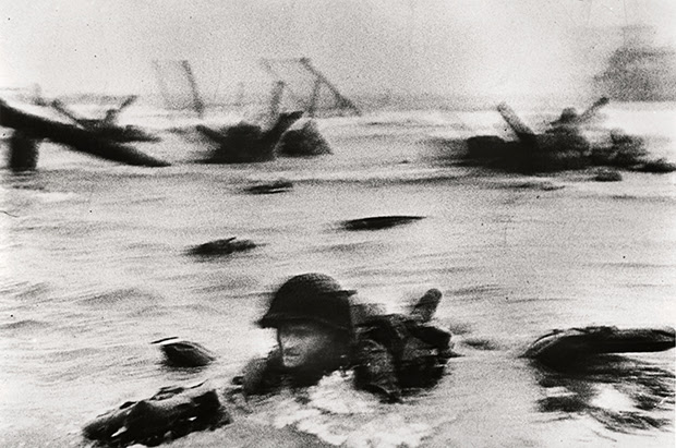 Robert Capa, [American troops landing on Omaha Beach, D-Day, Normandy, France], June 6 1944.