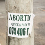 1024px-Abortion_Quick_&_Pain_Free_sign,_Joe_Slovo_Park,_Cape_Town,_South_Africa-3869