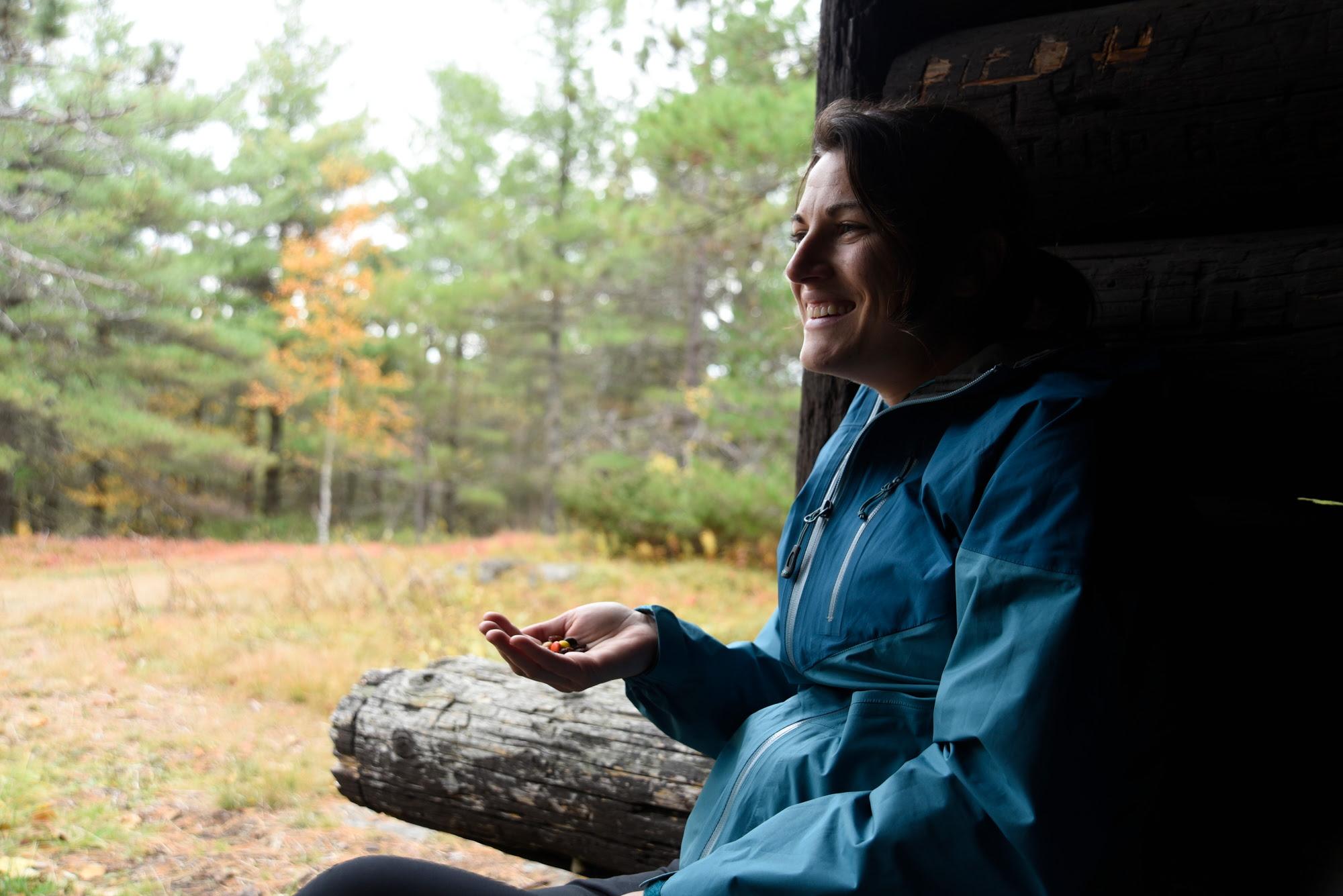 Hiker Eating Snack in Lean-to