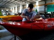 An employee works at the kayak factory in Buenos Aires, Argentina, Dec. 17, 2019.