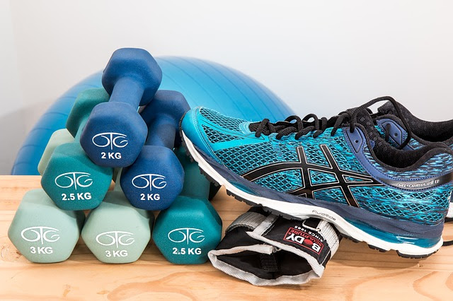 pair of running shoes, a set of dumbbells
