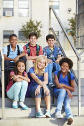 Group of children sitting on steps