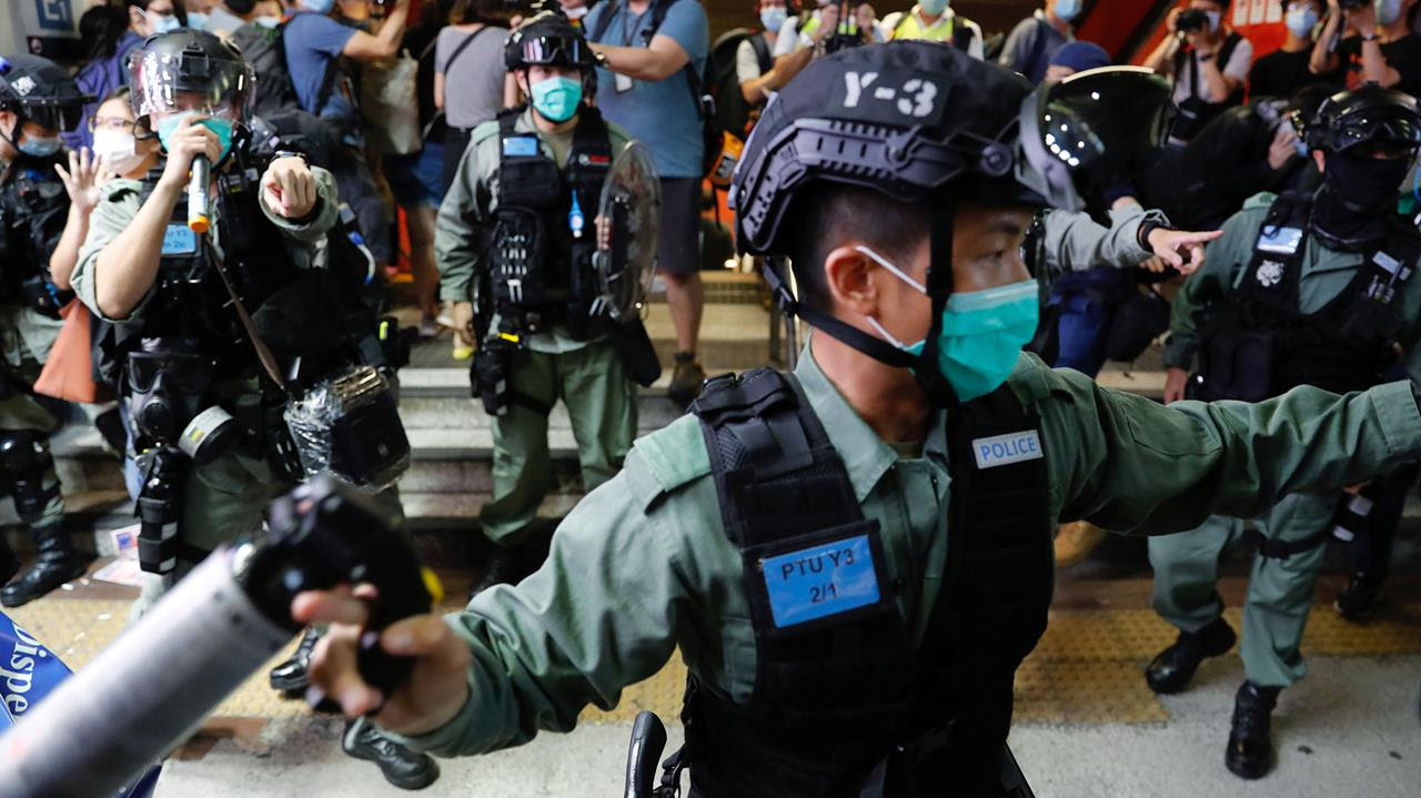 Riot police disperse pro-democracy demonstrators as they take part a singing song protest at Mong Kok, in Hong Kong, China June 12, 2020.