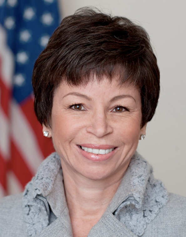 PICTURE OF VALERIE JARRET IN FRONT OF A UNITED STATES FLAG