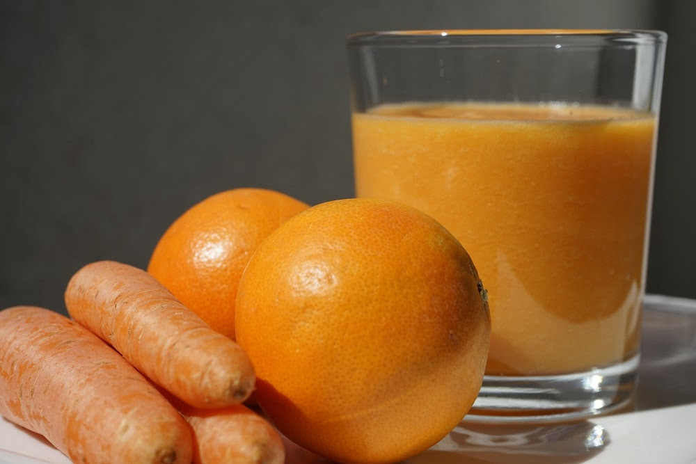 orange fruit on clear glass bowl