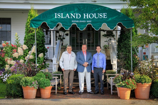 Family patriarch, Victor Callewaert, left, first leased the Island House Hotel in 969. His son Todd now serves as the hotel's president and grandson Andrew manages the Pancake House, also owned by the family.