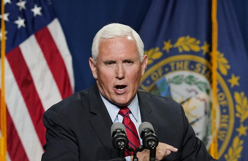 Mike Pence speaks directly into microphone during speech