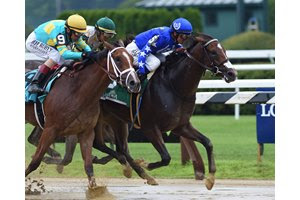 Comical (inside) takes the Schuylerville Stakes at Saratoga Race Course