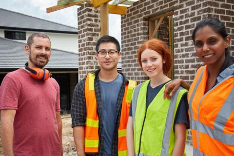 Four construction workers at a building site