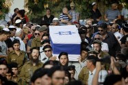 Friends and relatives of Major Amotz Greenberg (res.), 45 mourn during his funeral at the military cemetery in Hod HaSharon.