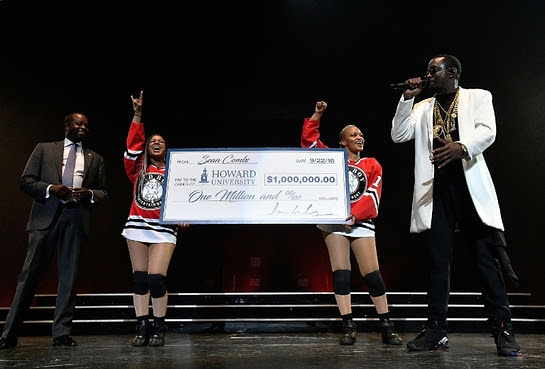 Sean Combs presents his Alma Matter Howard University's President Wayne A.I. Frederick, M.D., MBA with one million dollar check