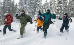 A family runs through snow. Link goes USDA page for increasing physical activity.
