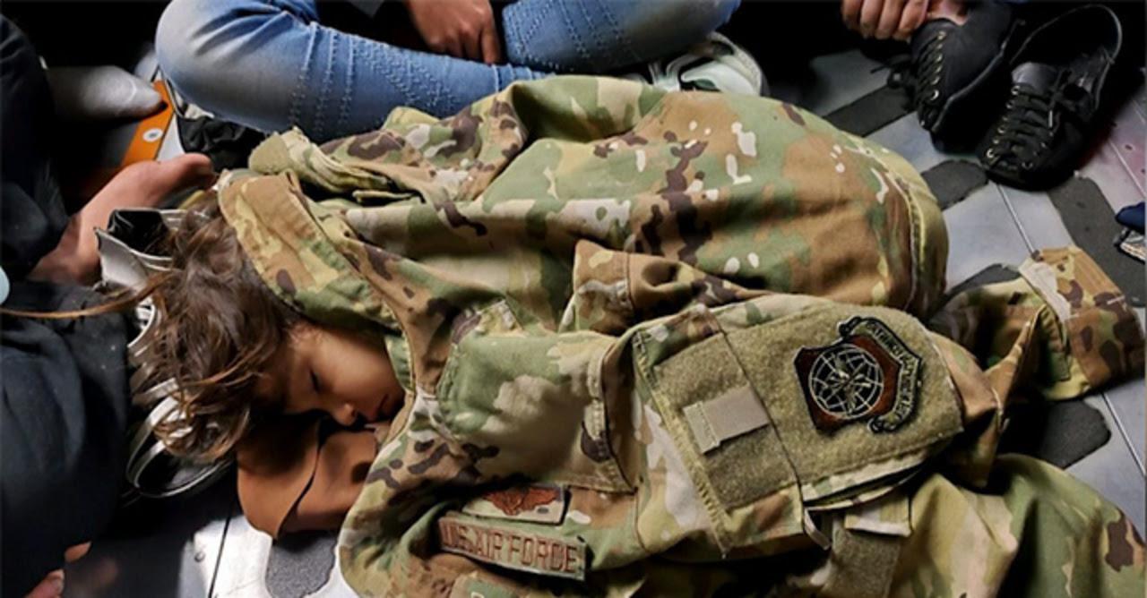 child under air force jacket