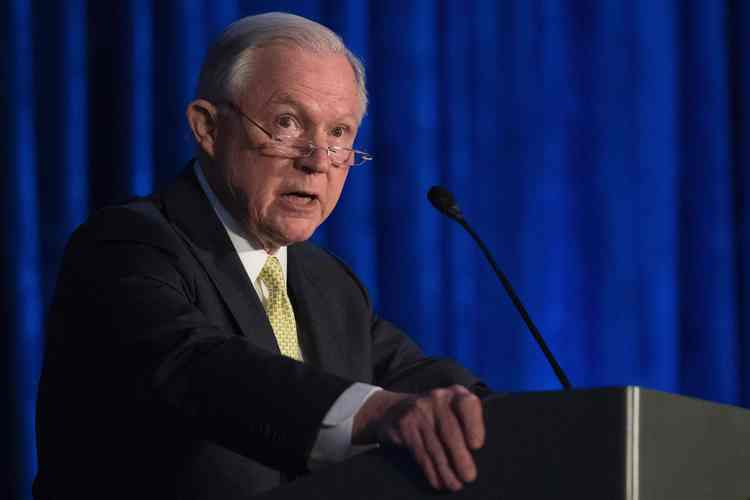 Jeff Sessions addresses the National Summit on Crime Reduction and Public Safety on Tuesday. (Jim Watson/AFP/Getty Images)</p>