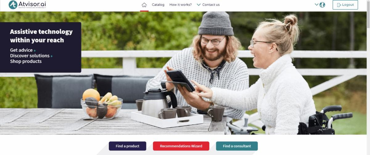 Screenshot of the ATvisor homepage showing a woman in a wheelchair sitting at a table with a man, using an iPad.