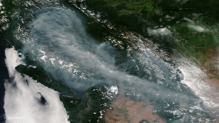 This infrared satellite photo, released by NOAA last Thursday, shows an immense cloud of smoke from wildfires burning in British Columbia drifting southeastward. (AFP/Getty Images)