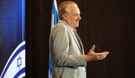 Mike Evans speaking in Jerusalem, today.