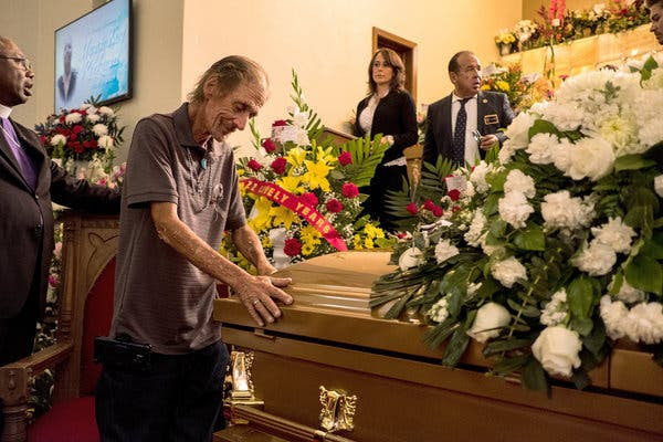 Antonio Basco with the casket of his wife Margie Reckard in El Paso on Friday. She was killed in the mass shooting at a local Walmart. (Credit: Joel Angel Juarez for The New York Times)