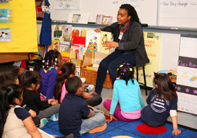 Group Leader reading to children