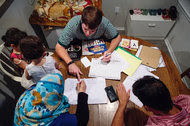"""A family of refugees receiving an English lesson from William Stocks, 23, in Marietta, Ga. """"My job is to serve these people,"""" Mr. Stocks said, """"because they need to be served."""""""