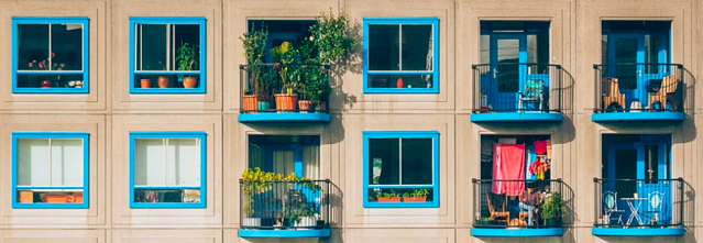 Apartment windows and balconies.