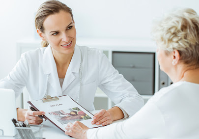 Doctor counsels patient about her health