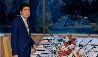 Japan's Prime Minister Shinzo Abe arrives for a dinner meeting at the Japanese ambassadors residence in Washington, Wednesday, March 30, 2016.  (AP Photo/Manuel Balce Ceneta)