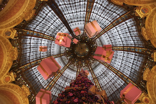 Galeries Lafayette, Paris, France, is especially notable; here, giant pink presents are suspended from the intricate dome.