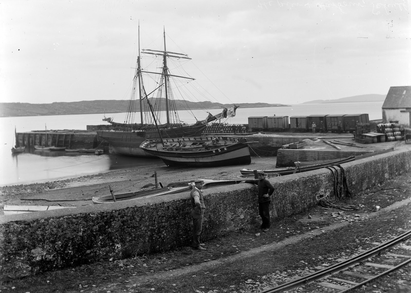 Boats moored by a harbour, in an unknown location (probably Schull, Co Cork) | by National Library of Ireland on The Commons