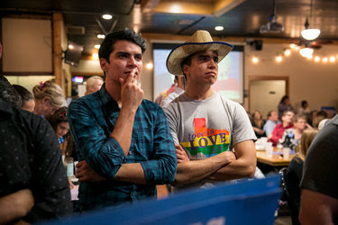 Oscar Silva and John Arispe watched the first presidential debate between Hillary Clinton and Donald J. Trump in Austin, Tex., on Sept. 26.