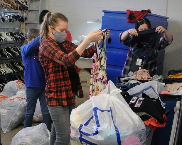 Students sorting through donated clothing