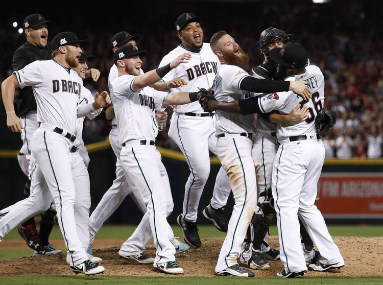 The Arizona Diamondbacks celebrate after the National League wild-card playoff baseball game. (Matt York/AP)