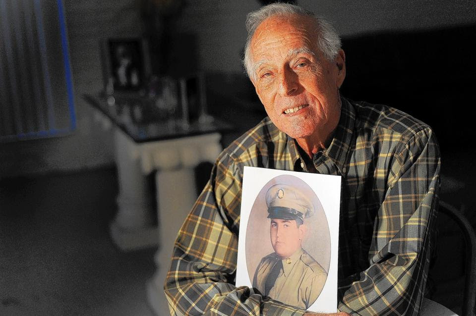Mitchel Libman has lobbied for worthy veterans to recieve the Medal of Honor.   Libman is a Korean war veteran himself.  Here he holds a photo of Leonard Kravitz, one of the nominees that he has rallied for.