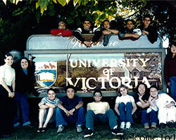 Old photo of ELC students in front of the University of Victoria sign