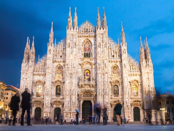 It took                                                           over five                                                           centuries to                                                           complete the                                                           magnificent                                                           Gothic                                                           cathedral                                                           known as the                                                           Duomo in                                                           Milan. It's                                                             the fourth                                                           largest church                                                           in the world                                                           and has 135                                                           marble spires                                                           and well over                                                           3,000 statues                                                           lining the                                                           exterior.