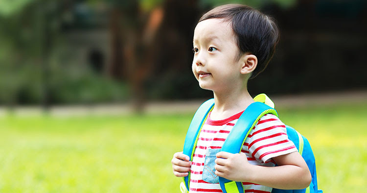 Young child preparing to go to school