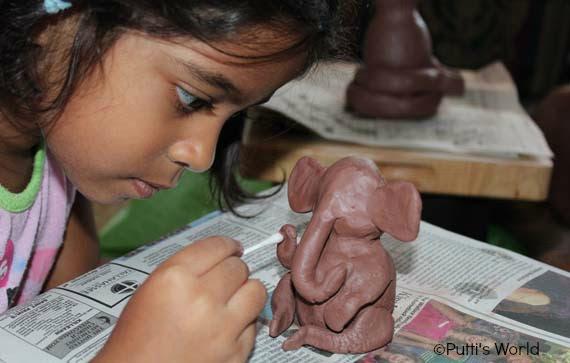 Kids make clay ganesha